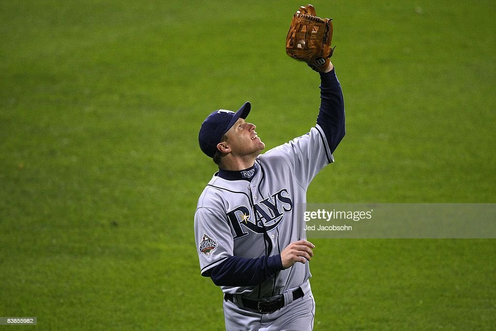 Gabe Gross #26 of the Tampa Bay Rays runs under a fly ball in the outfield against the Philadelphia Phillies during game three of the 2008 MLB World Series on October 25, 2008 at Citizens Bank Park in Philadelphia, Pennsylvania.