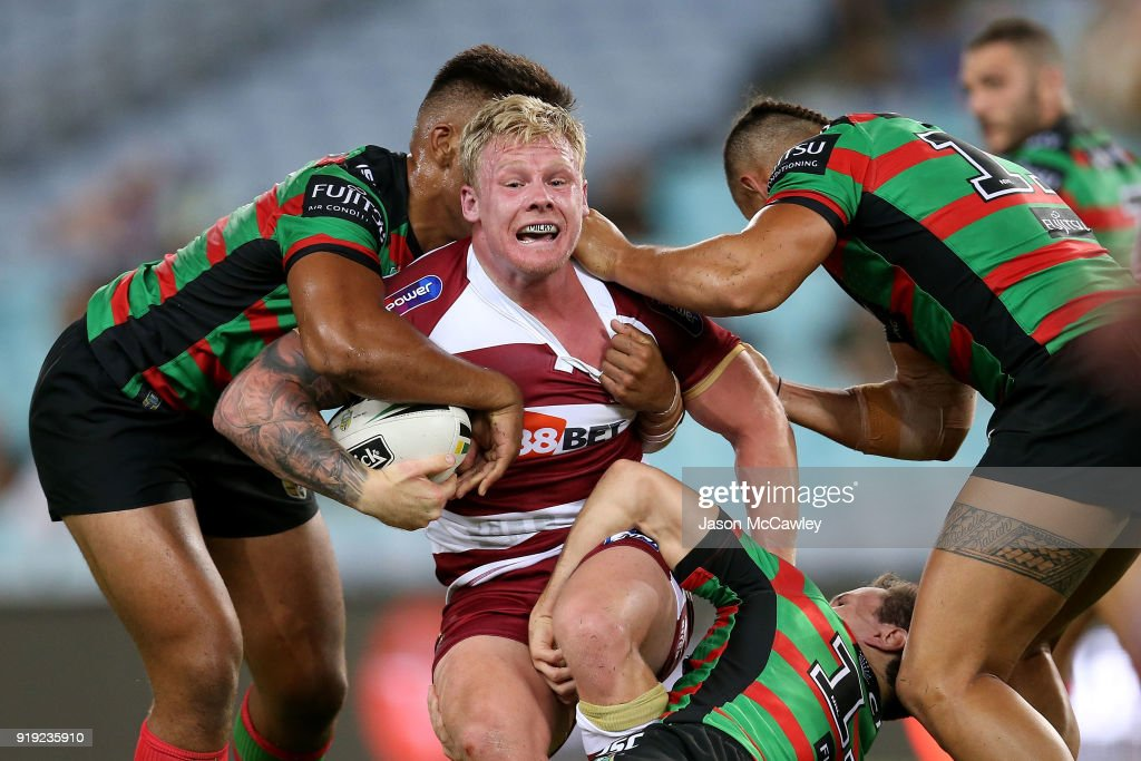 Gabe Hamlin of Wigan is tackled during the NRL trial match between the South Sydney Rabbitohs and Wigan at ANZ Stadium on February 17, 2018 in Sydney, Australia.