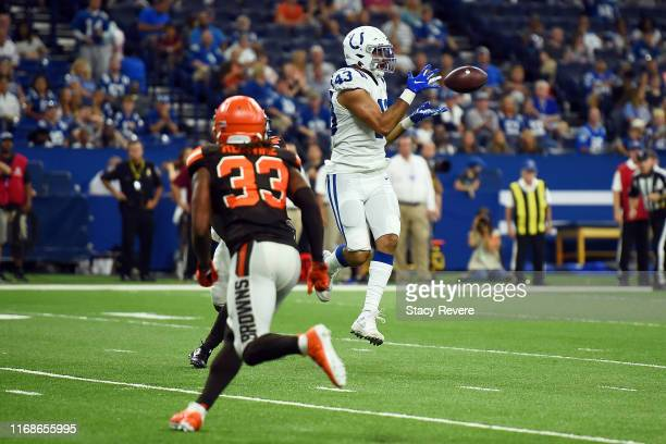 Gabe Holmes of the Indianapolis Colts catches a pass for a touchdown during the second half of a preseason game against the Cleveland Browns at Lucas...