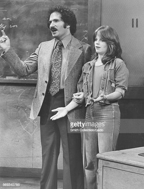 Gabe Kaplan and Debralee Scott standing in front of a classroom on the television sitcom Welcome Back Kotter August 10 1976