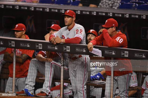 Gabe Kapler of the Philadelphia Phillies in the dugout in the first inning against the Miami Marlins at Marlins Park on April 30 2018 in Miami Florida