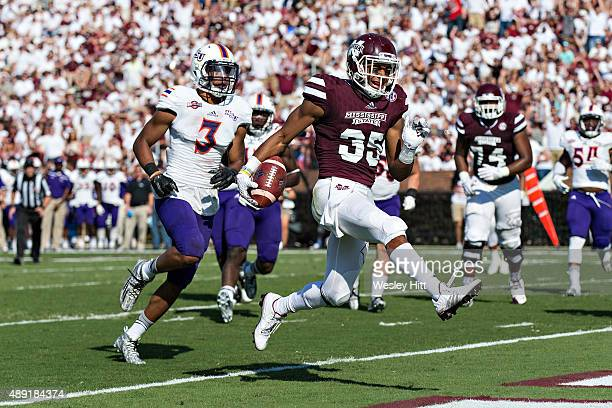 Gabe Myles of the Mississippi State Bulldogs runs the ball in for a touchdown against the Northwestern State Demons at Davis Wade Stadium on...
