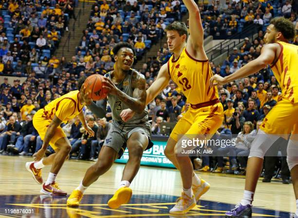 Gabe Osabuohien of the West Virginia Mountaineers drives the lane against Michael Jacobson of the Iowa State Cyclones at the WVU Coliseum on February...