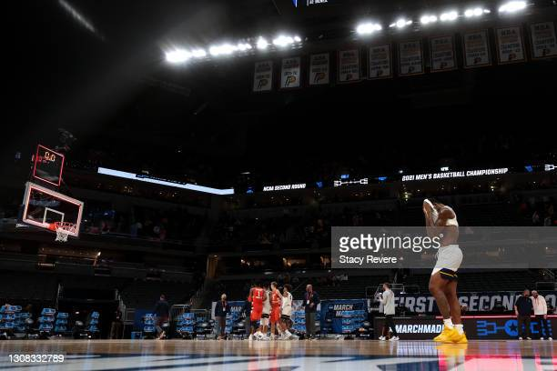 Gabe Osabuohien of the West Virginia Mountaineers reacts after being defeated by the Syracuse Orange in their second round game of the 2021 NCAA...