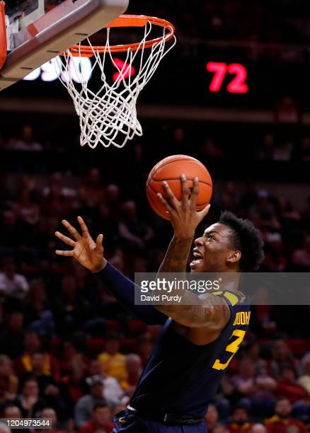 Gabe Osabuohien of the West Virginia Mountaineers takes a shot in the second half of the play against the Iowa State Cyclones at Hilton Coliseum on...