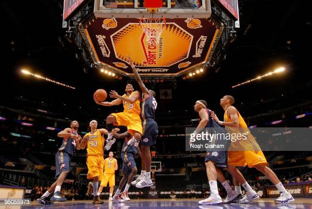 Gabe Pruitt of the Los Angeles DFenders gets to the hoop against Amara Sy and the Bakersfield Jam at Staples Center on December 22 2009 in Los...