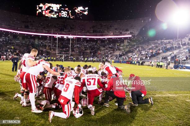 Gabe Rahn of the Nebraska Cornhuskers leads a group of players from both teams at center field after the game between the Penn State Nittany Lions...