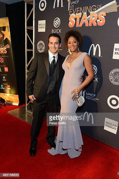 Gabe Solis and Trina Braxton attends UNCF's 33rd annual An Evening With The Stars at Boisfeuillet Jones Atlanta Civic Center on April 6, 2014 in...