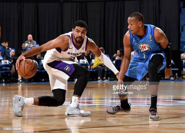 Gabe Vincent of the Stockton Kings dribbles against Demarcus Holland of the Agua Caliente Clippers of Ontario on January 19 2019 at Citizens Business...