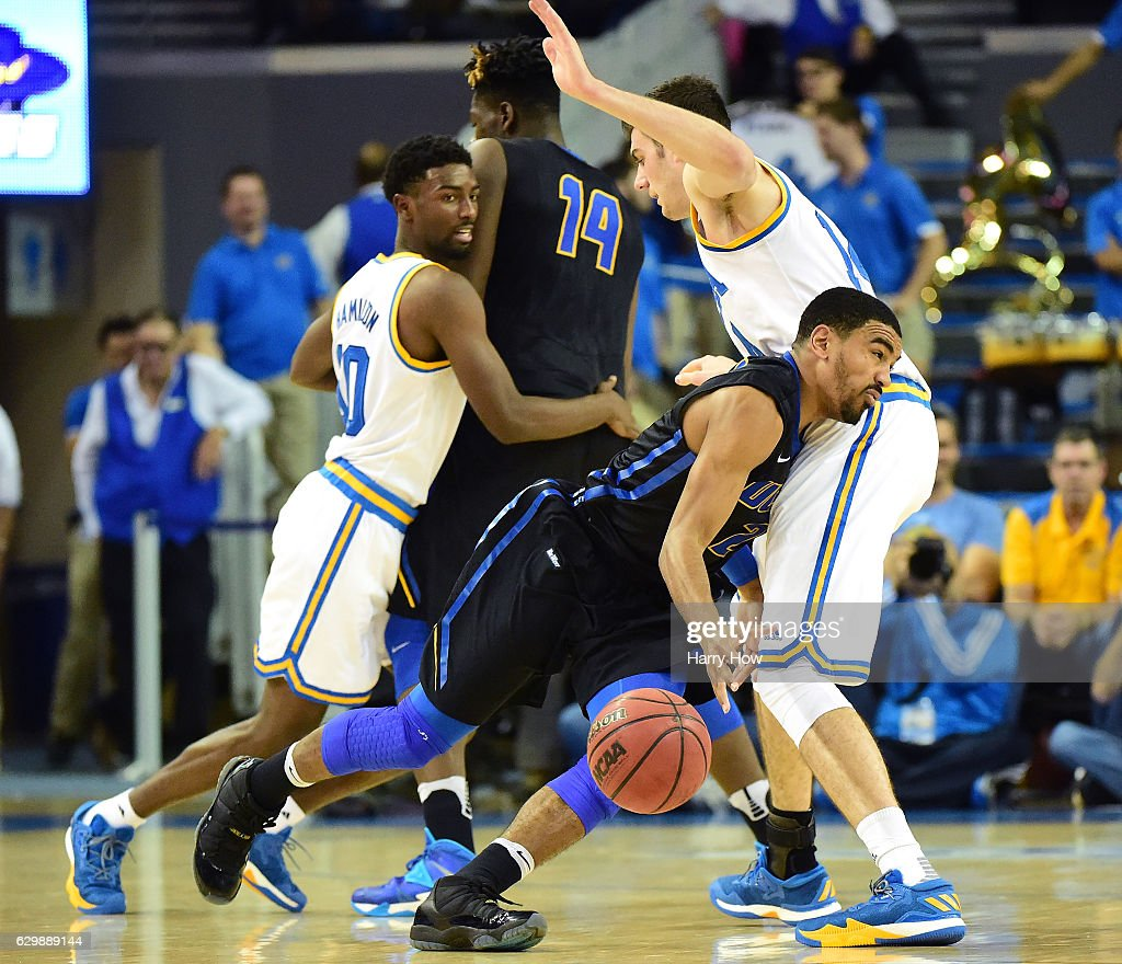 Gabe Vincent #2 of the UC Santa Barbara Gauchos loses the ball as he is guarded by Gyorgy Goloman #14 of the UCLA Bruins during a 102-62 win over the UC Santa Barbara Gauchos at Pauley Pavilion on December 14, 2016 in Los Angeles, California.