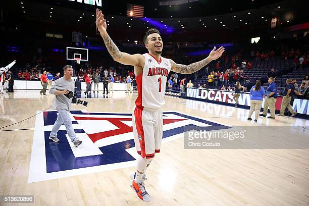 Gabe York of the Arizona Wildcats celebrates as he runs off the court after the college basketball game against the California Golden Bears at McKale...