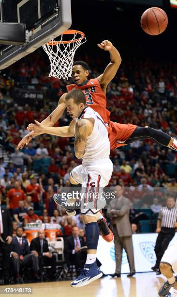 Gabe York of the Arizona Wildcats is fouled by Princeton Onwas of the Utah Utes during a quarterfinal game of the Pac-12 Basketball Tournament at the...