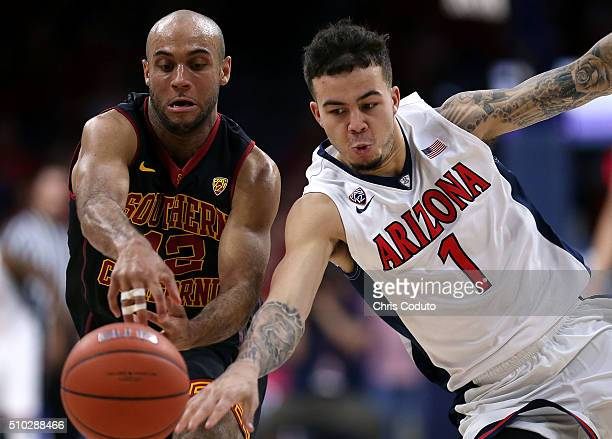 Gabe York of the Arizona Wildcats steals the ball from Julian Jacobs of the USC Trojans during the first half of the college basketball game at...