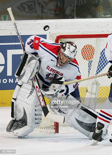 Gaber Glavic of Slovenia makes a mask save against Austria in the IIHF World Men's Championships relegation game at the Olympic Hall May 11 2005 in...