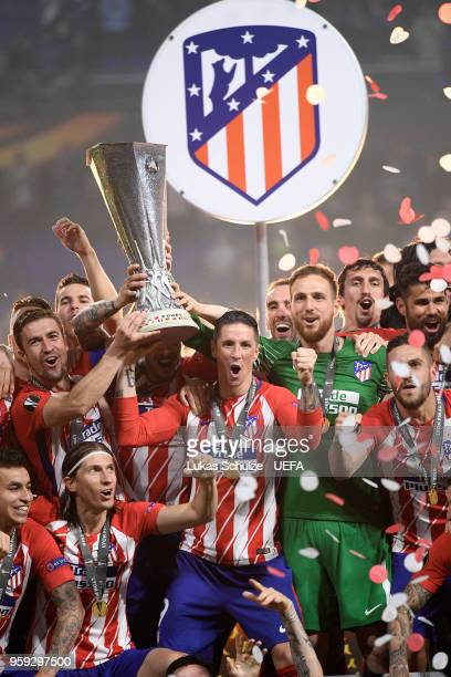 Gabi and Fernando Torres of Atletico Madrid lift the Europa League trophy following victory after the UEFA Europa League Final between Olympique de...