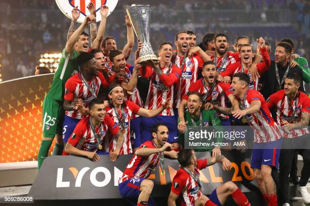 Gabi and Fernando Torres of Atletico Madrid lift the trophy with their teammates at the end of the UEFA Europa League Final between Olympique de...