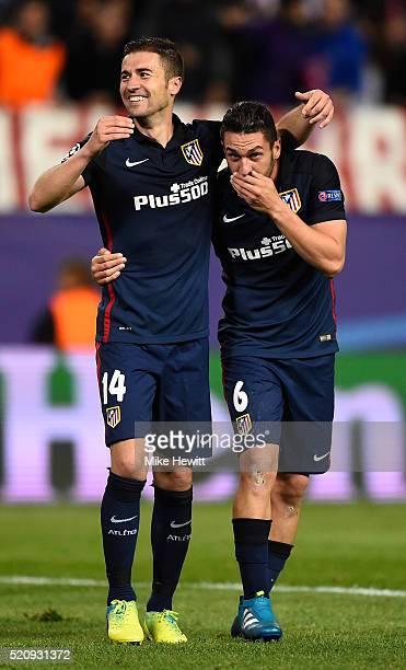 Gabi and Koke of Atletico Madrid celebrate victory after the UEFA Champions League quarter final second leg match between Club Atletico de Madrid and...