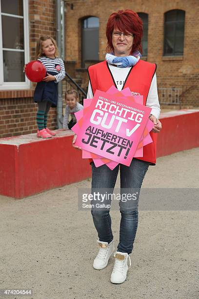 Gabi Born who is employed parttime by the town of Luebbenau in a day care center and has joined a strike organized by the verdi labor union poses for...