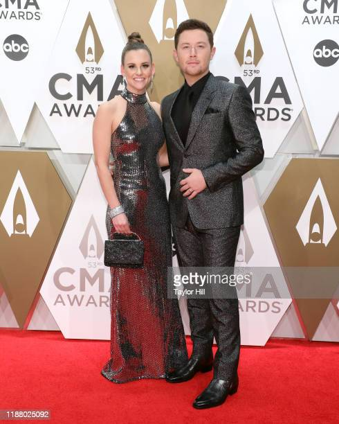 Gabi Dugal and Scotty McCreery attend the 53nd annual CMA Awards at Bridgestone Arena on November 13 2019 in Nashville Tennessee