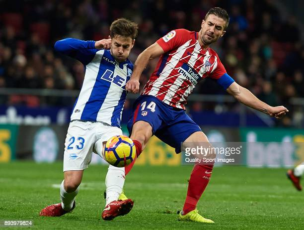 Gabi of Atletico de Madrid competes for the ball with Alvaro Medran of Deportivo Alaves during the La Liga match between Atletico Madrid and...