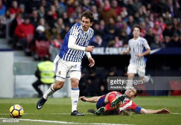 Gabi of Atletico de Madrid in action against Mikel Oyarzabal of Real Sociedad during the La Liga match between Club Atletico Madrid and Real Sociedad...