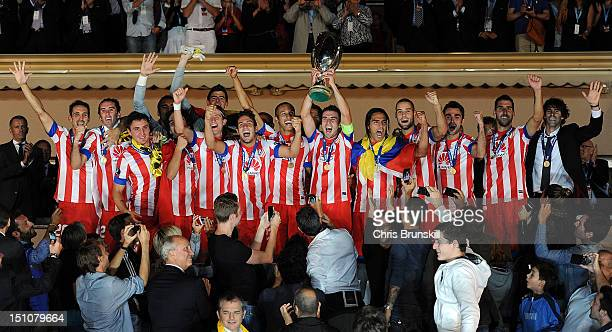 Gabi of Atletico Madrid lifts the UEFA Super Cup following the match between Chelsea and Atletico Madrid at Louis II Stadium on August 31 2012 in...