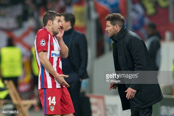 Gabi of Atletico Madrid speak with Head coach Diego Simeone of Atletico Madrid during the UEFA Champions League Round of 16 first leg match between...