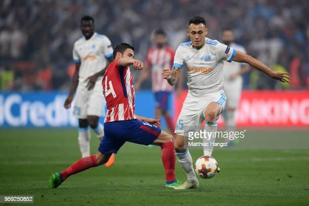 Gabi of Atletico Madrid tackles Lucas Ocampos of Marseille during the UEFA Europa League Final between Olympique de Marseille and Club Atletico de...