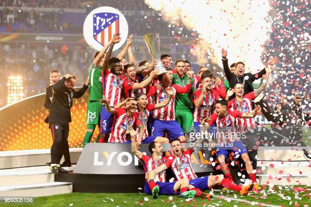 Gabi of Club Atletico de Madrid and his team lift the trophy after winning during the UEFA Europa League Final between Olympique de Marseille and...