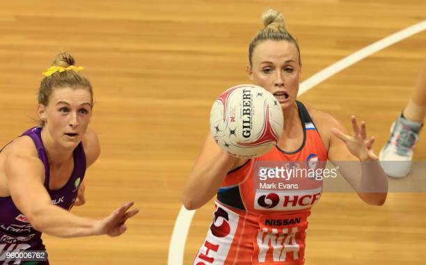 Gabi Simpson of the Firebirds and Kim Green of the Giants compete for the ball during the round four Super Netball match between the Giants and the...