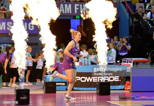 Gabi Simpson of the Firebirds enters the court during the round 13 Super Netball match between the Firebirds and the Thunderbirds at Brisbane...