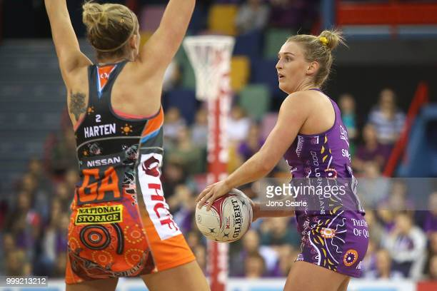 Gabi Simpson of the Firebirds looks to pass during the round 11 Super Netball match between the Firebirds and the Giants at Brisbane Entertainment...