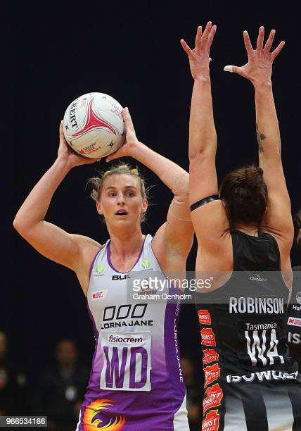 Gabi Simpson of the Firebirds looks to pass during the round five Super Netball match between the Magpies and the Firebirds at the Launceston...