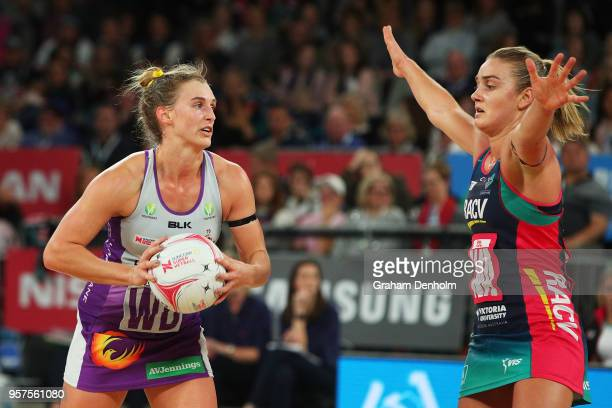 Gabi Simpson of the Firebirds looks to pass during the round three Super Netball match between the Vixens and the Firebirds at Hisense Arena on May...