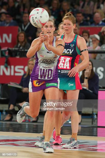 Gabi Simpson of the Firebirds passes during the round three Super Netball match between the Vixens and the Firebirds at Hisense Arena on May 12 2018...