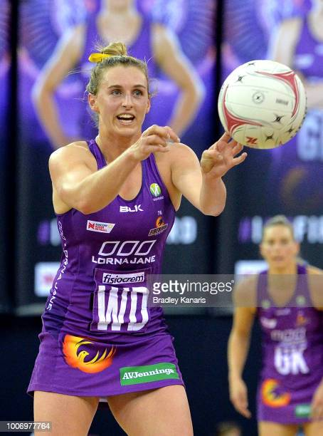Gabi Simpson of the Firebirds passes the ball during the round 13 Super Netball match between the Firebirds and the Thunderbirds at Brisbane...