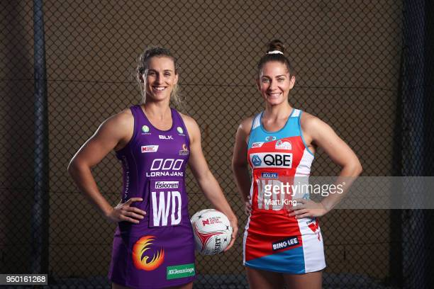 Gabi Simpson of the Queensland Firebirds and Abbey McCulloch of the NSW Swifts pose during the Suncorp Super Netball 2018 season launch on April 23...