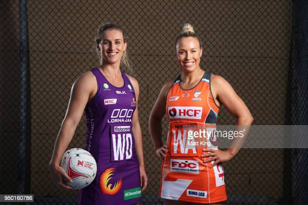 Gabi Simpson of the Queensland Firebirds and Kimberlee Green of Giants Netball pose during the Suncorp Super Netball 2018 season launch on April 23...