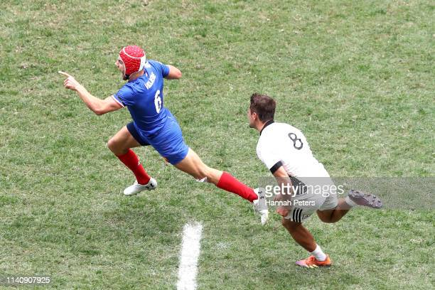 Gabin Villiere of France makes a break to score a try against New Zealand on day three of the Cathay Pacific/HSBC Hong Kong Sevens at the Hong Kong...