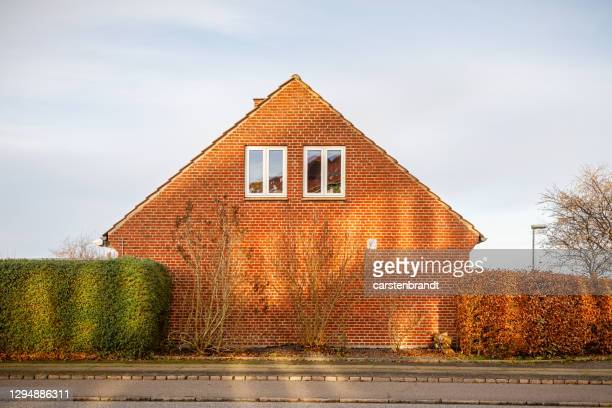 gable of a single family house in winter sun - danish culture stock pictures, royalty-free photos & images