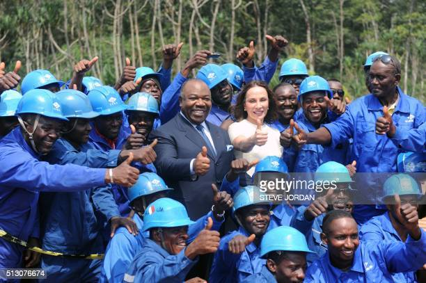 Gabon President Ali Bongo Ondimba flanked by his wife Sylvia Bongo Ondimba gestures after having announced on February 29 2016 in PortGentil that he...