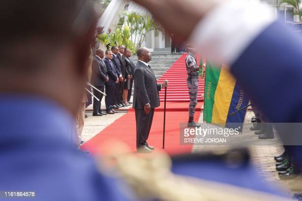 TOPSHOT Gabon President Ali Bongo reviews troops at a ceremony in Libreville on August 16 2019 at the Mausoleum of the Country First President during...