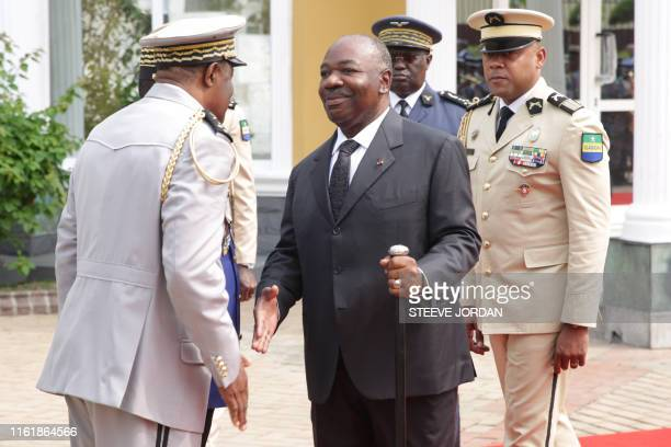 Gabon President Ali Bongo shakes hands at a ceremony in Libreville on August 16 2019 at the Mausoleum of the Country First President during a wreath...