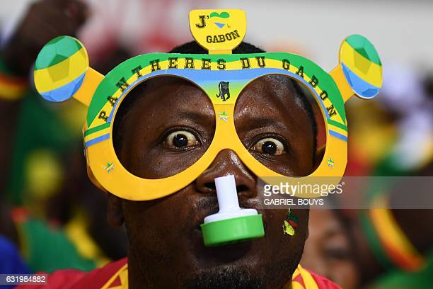 Gabon supporter blows a whistle ahead of the 2017 Africa Cup of Nations group A football match between Cameroon and GuineaBissau at the Stade de...