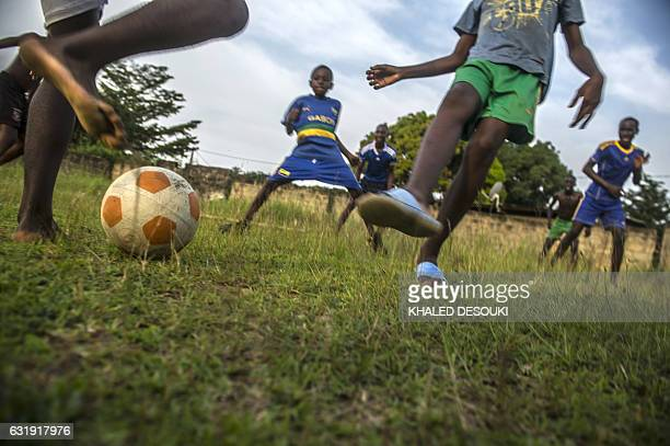 Gabonese boys play a football match in Franceville on January 17 as the Africa Cup of Nations tournament takes place in Gabon / AFP / KHALED DESOUKI