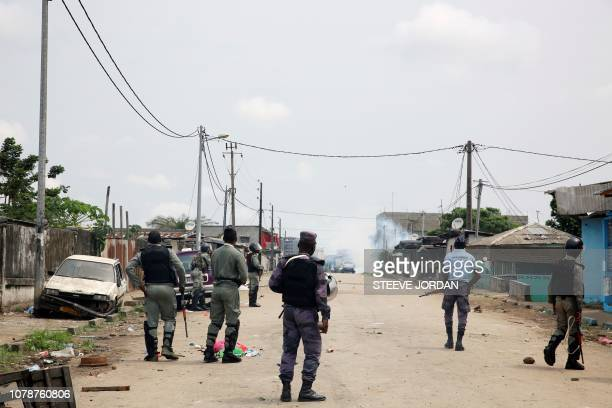 TOPSHOT Gabonese gendarmes patrol in the Cocotiers neighbourhood near the headquarters of the national broadcaster Radiodiffusion Television...