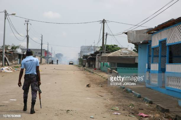 Gabonese gendarmes patrol in the Cocotiers neighbourhood near the headquarters of the national broadcaster Radiodiffusion Television Gabonaise in...