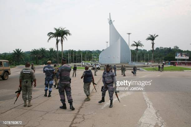 Gabonese gendarmes patrol on the Democracy square in Libreville on January 7 2018 after a group of soldiers sought to take power in Gabon while the...