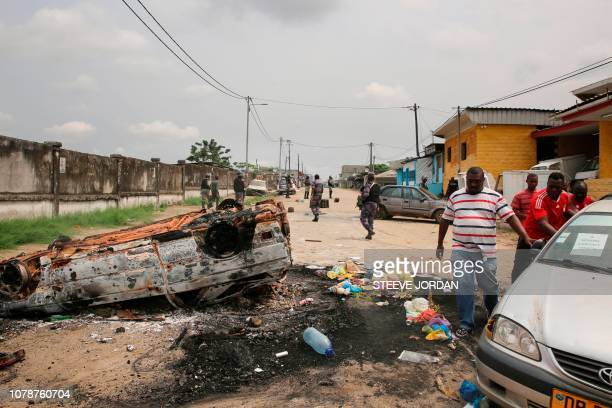 Gabonese gendarmes patrol while people demonstrate in the Cocotiers neighbourhood near the headquarters of the national broadcaster Radiodiffusion...