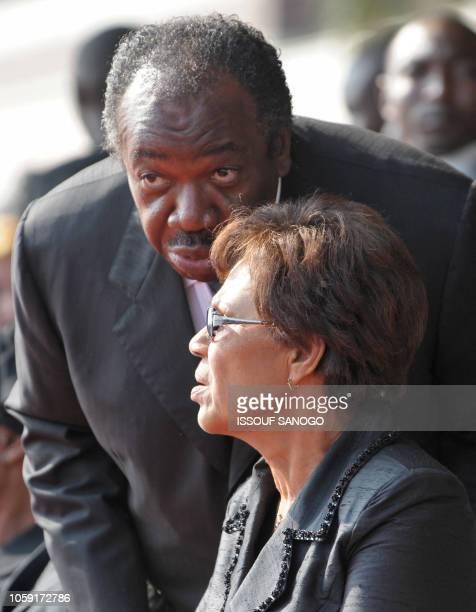Gabonese Interim President Rose Francine Rogombe talks with Minister of defense and son of Gabonese late President Omar Bongo Ali Ben Bongo as they...